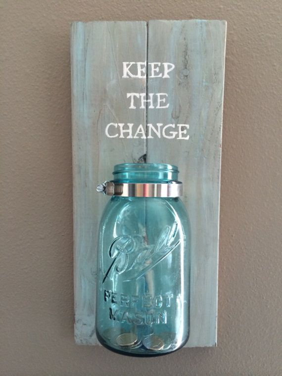 Pallet art sign- Keep the change. Made from recycled pallet wood. Colors are grey and turquoise with white lettering. Turquoise quart size mason jar