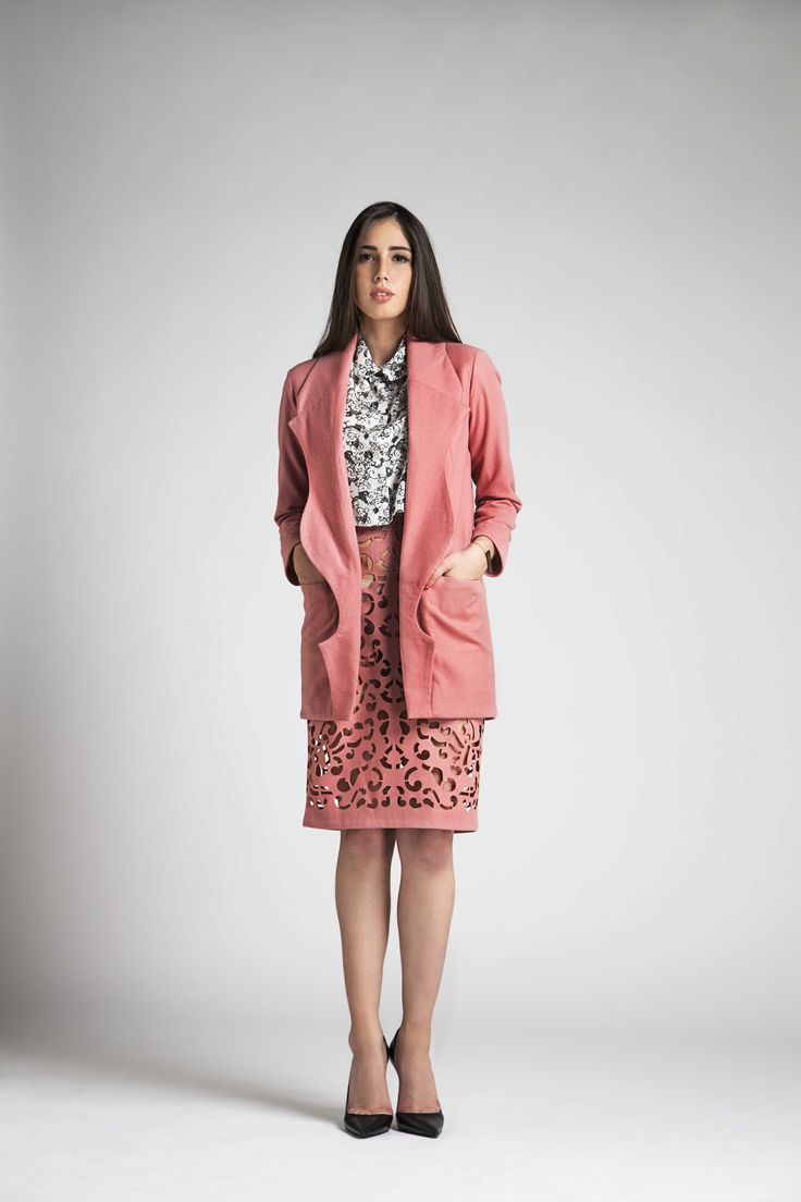 Set of wool coat with fantasy label and die-cut skirt. Printed silk shirt. Designed by MARIA ROVIRA