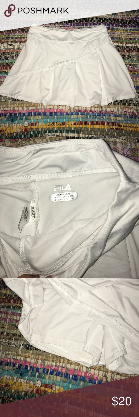 Tennis or running skort White FILA running/tennis skirt. VERY SOFT and breathable. Fila Shorts Skorts