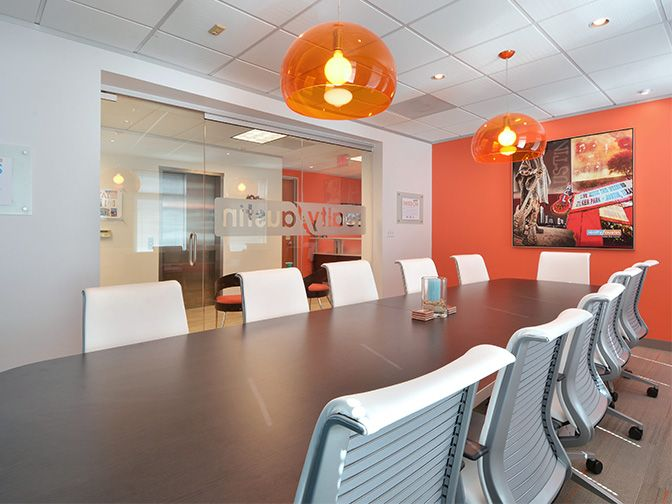 conference room with an orange accent wall at the central on office accent wall color id=60309