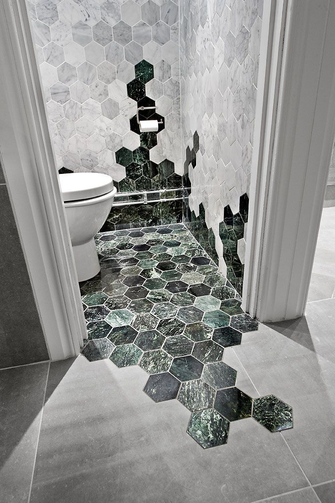Hexagon tiles are one of the freshest new trends in bathroom design, and one of our favourites. This rather striking effect has been achieved by thinking outside the box and daring to be a little more creative. Great stuff!