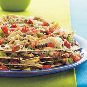 Use rotisserie chicken, salsa, bean dip, cheese and tortillas in this easy take on a traditional tostada.