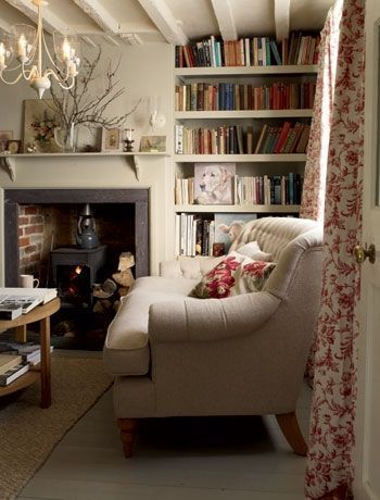 cozy looking room... couch, curtains and books.