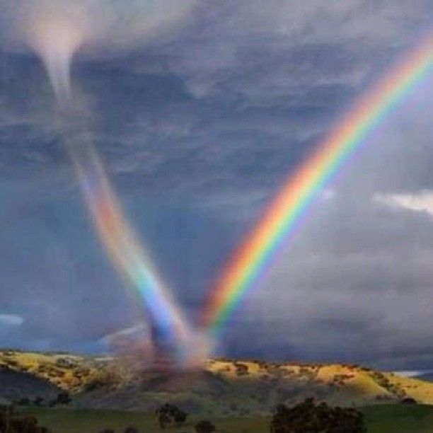 Rainbow meets Tornado...if this is not photo-shopped then it is God amazing.  If it is photo-shopped then it is still beautiful