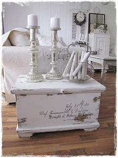 Distressed, painted blanket chest featuring a quote. If H is done with the toybox, annie Sloan chalkpaint in pink or white for M's room.
