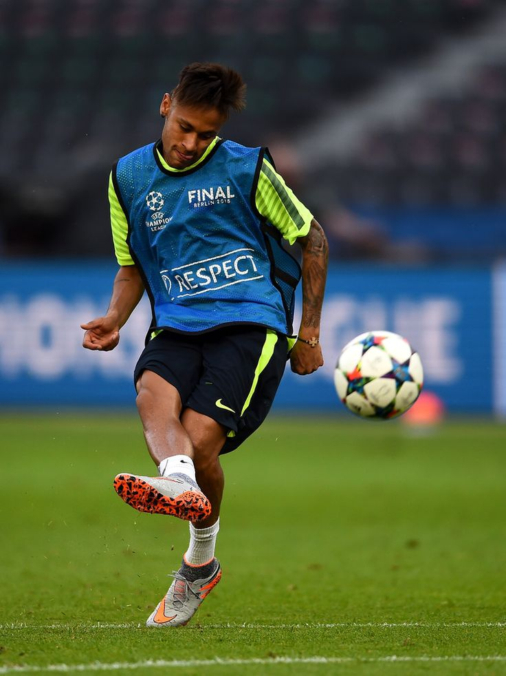 Neymar of Barcelona shoots during an FC Barcelona training session on the eve of the UEFA Champions League Final match against Juventus at Olympiastadion on June 5, 2015 in Berlin, Germany.
