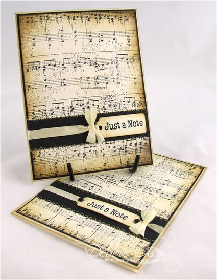 Spellbinders label dies, Vintage Photo Distress Ink to sponge the edges of both the music and the tags. I sewed on a strip of black cardstock, then tied the tag with an ivory silk ribbon (May Arts).