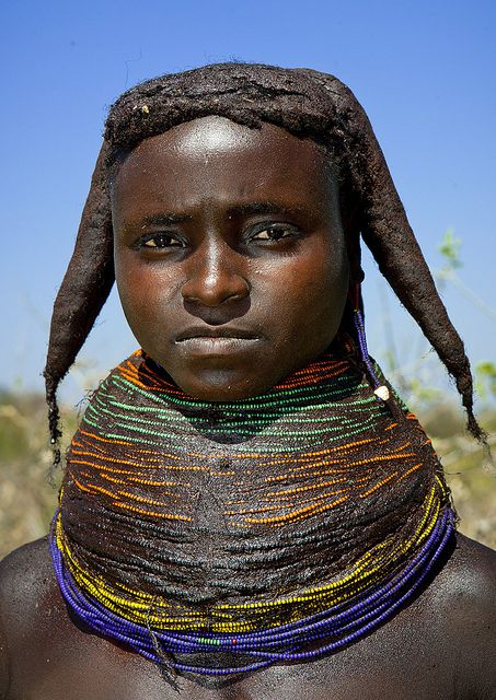 Mwila giant necklace - Angola. Mwila (or Mwela, Mumuhuila, or Muhuila) women are famous for their very special hairstyles.