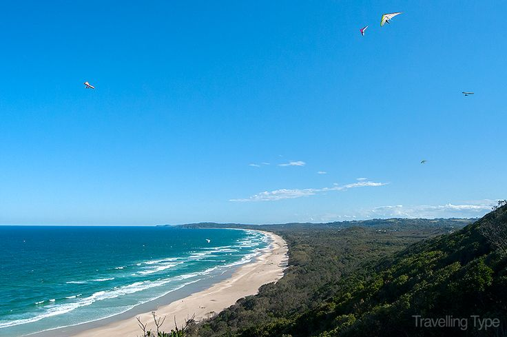 Great day for hang gliding in Byron Bay. How many can you count?
