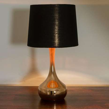 Simple in design, this copper plated table lamp is fashioned with a curved base, black cotton shade and has a versatile 140cm cable....