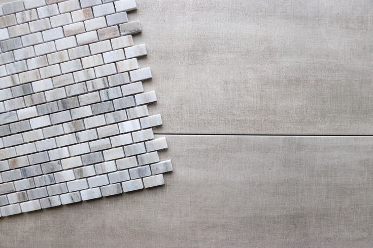 Muted porcelain tiles make the colours in this marble mini subway tile mosaic pop.