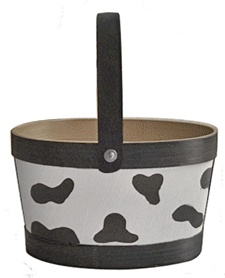 How cute - a cow print gift basket! Fill with goodies but I betcha the cow gift basket will get all the comments...