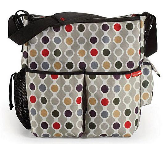 Bolso SKip Hop Duo Wave Dot.  http://www.mibabyclub.com/tienda/pasear-al-bebe/bolsos-para-sillas-de-paseo-y-cambiadores-plegables/bolso-skip-hop-duo-wave-dot.html
