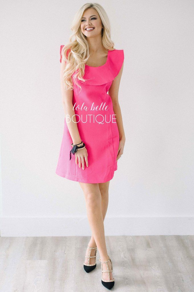 Cute, classy and feminine! We adore this new Kentucky Derby Dress! Made of a textured hot pink material, this dress is fully lined, has a back zipper closure and ruffle neck line. Amanda is a size 0/2