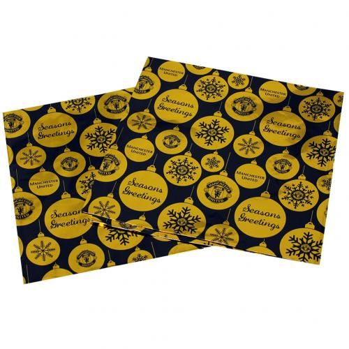 Two sheets of Manchester United Christmas wrapping paper in black and gold and featuring snowflakes and the club crest. FREE DELIVERY on all of our gifts