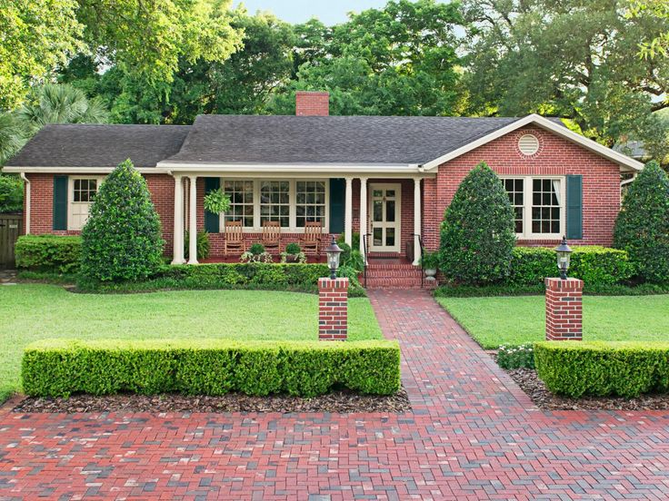 Extending the walkway into a brick parking pad created space for cars without compromising the house's character. #curbappeal #hgtvmagazine http://www.hgtv.com/design/outdoor-design/landscaping-and-hardscaping/copy-the-curb-appeal-jacksonville-florida-pictures?soc=pinterest