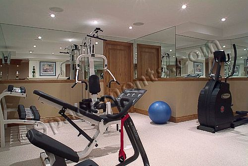 Basement workout room with mirrored walls.  Good compromise maybe?