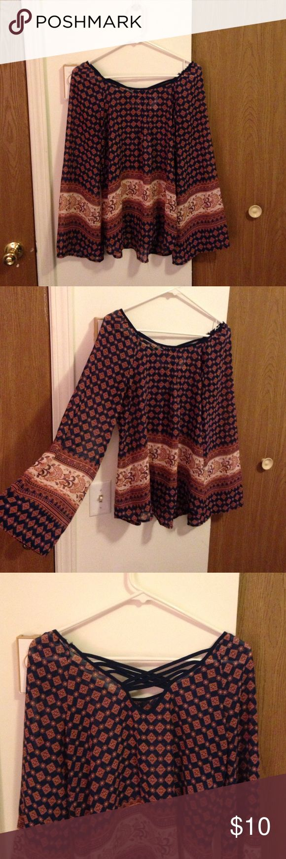 Charming Charlie long sleeve shirt This beautiful shirt is very thin, flowy, and a perfect way to dress up a pair of jeans. I always found it very flattering. A few of the threads are slightly torn in the upper back, but never noticeable! (You can see in picture). Otherwise in wonderful shape! Tops