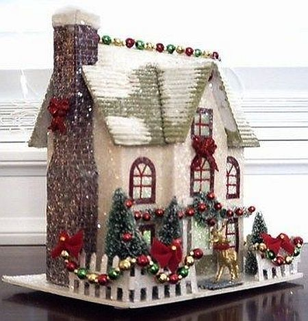 A christmas putz super cute love the garland and lights on the roof.