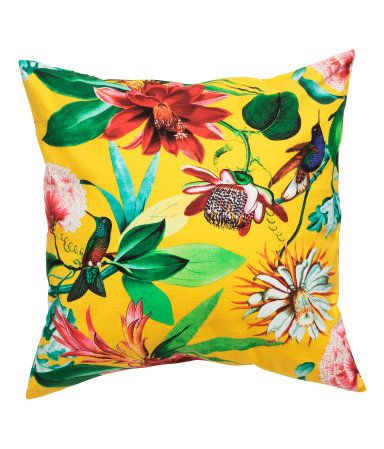 Cushion cover in woven cotton fabric with a printed pattern. Concealed zip.