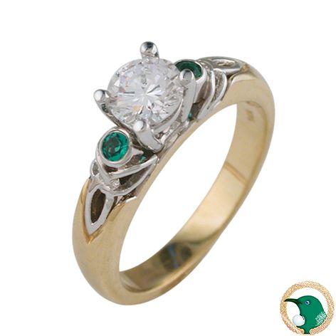Our ladies Celtic Diamond and Emerald Trinity ring on an 18ct yellow gold band, and 18ct white gold knot work and claw set - has trinity weave shoulders which feature a round 2mm natural emerald in each. A claw set .50ct round brilliant cut diamond is the stand out feature in this design.