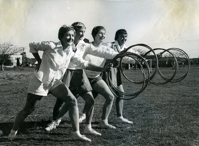 Students exercise with hoola hoops, Newcastle Teachers' College, NSW, Australia - 1955