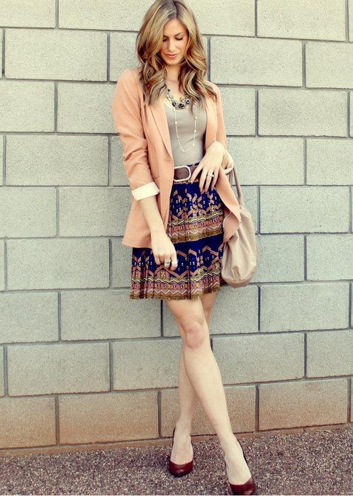 light pink blazer and navy skirt