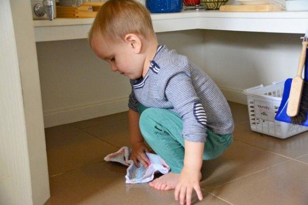 Child Playing On Kitchen Floor
