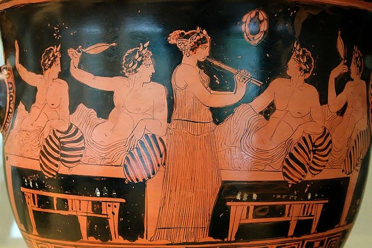 A symposium scene on a red-figure vase. It was at parties such as this that the Eleusinian Mysteries were performed, outside of their appropriate context. It was a great sacrilege that was uncovered during the Athenians' investigation into the vandalism of the herms.