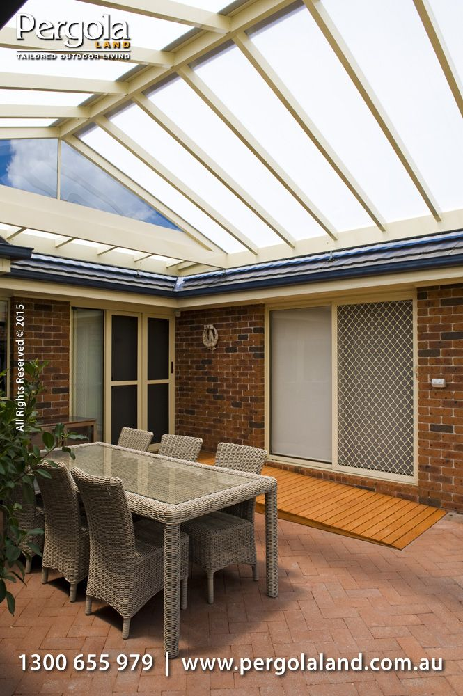 Gable Aluminium Frame Pergola fitted with Policarb I.R. and fixed to the house with Roof Brackets. The polycarbonate lets the light through and reduces heat while the Gable frame on roof brackets provide better air flow keeping the space cooler.