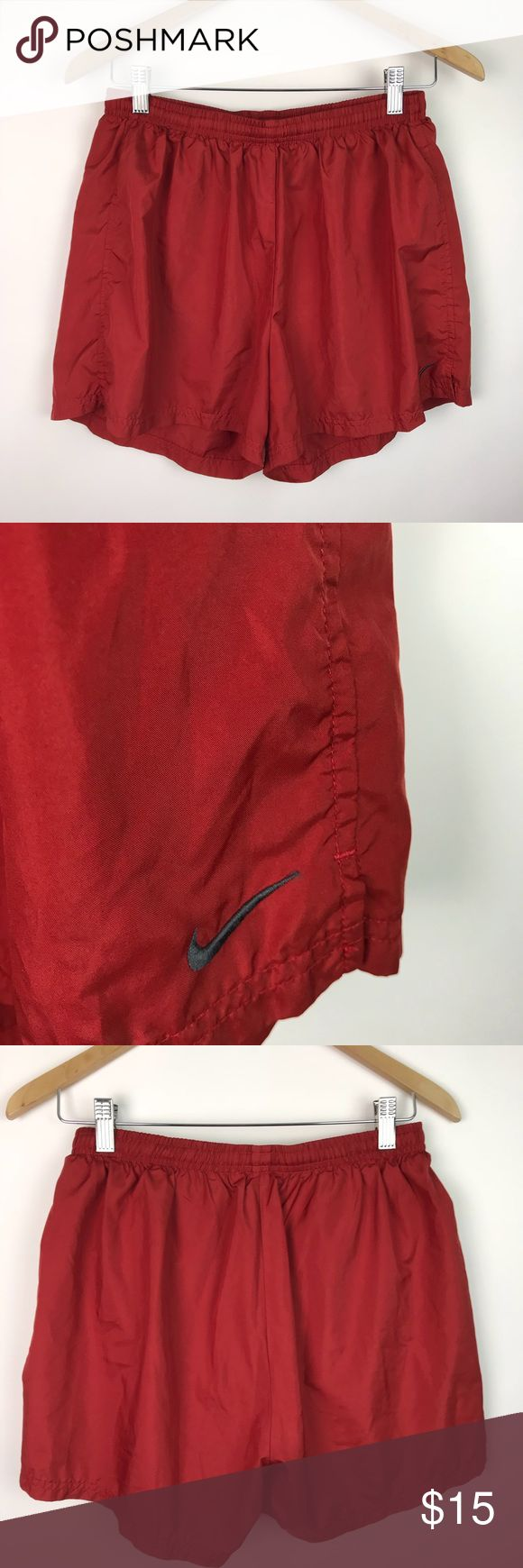 NIKE Women's Classic Basic Athletic Shorts AO73 Nike Womens Classic Running Shorts Basic Integrated Panty Red Drawstring L AO72 VGUC...NO stains holes rips or pilling  These running shorts by Nike feature a deep red 100% polyester textile, in basic classic style. They boast an elastic waistband with interior drawstring, integrated panty,interior pocket, longer profile, embroidered logo left hem. Perfect for the woman who wants a less revealing fitness shirt than those sold currently, with no…