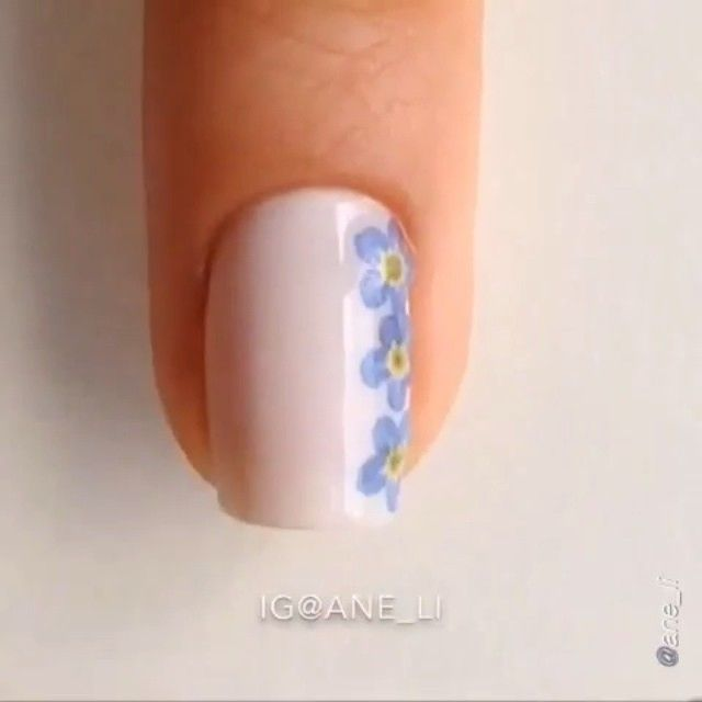 Nail DIY tutorial. By @ane_li Here's a tutorial for the DIY dried flower nails I did today and yes, these are actual, real flowers I used forget-me-nots cause they're so tiny that they fit perfectly on my nails Description will be below ⬇ Polishes used: Essie 'Ballet slippers', 'Good to go' Opi 'Matte topcoat' Revlon 'Top coat' You'll also need: - a toothpick - some papertowel - real (preferably tiny) flowers - a bunch of books - some aluminium foil or just some regular paper - a pair of…
