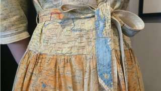 A dress made from silk maps given to RAF soldiers in WW2 to help them find a route out of enemy territory has been sold for an undisclosed sum. The dress, made from 'escape and evade' maps, is thought to be from 1945-50. Maps were printed on silk during the war because it is durable and was easy to conceal in soldiers' clothing.
