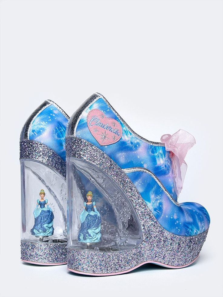 - Pay homage to Cinderella in these iconic wedge heels featuring digital print uppers with silver glitter platforms and organza ribbon laces. Embossed clear lucite heels with rotating Cinderella figur