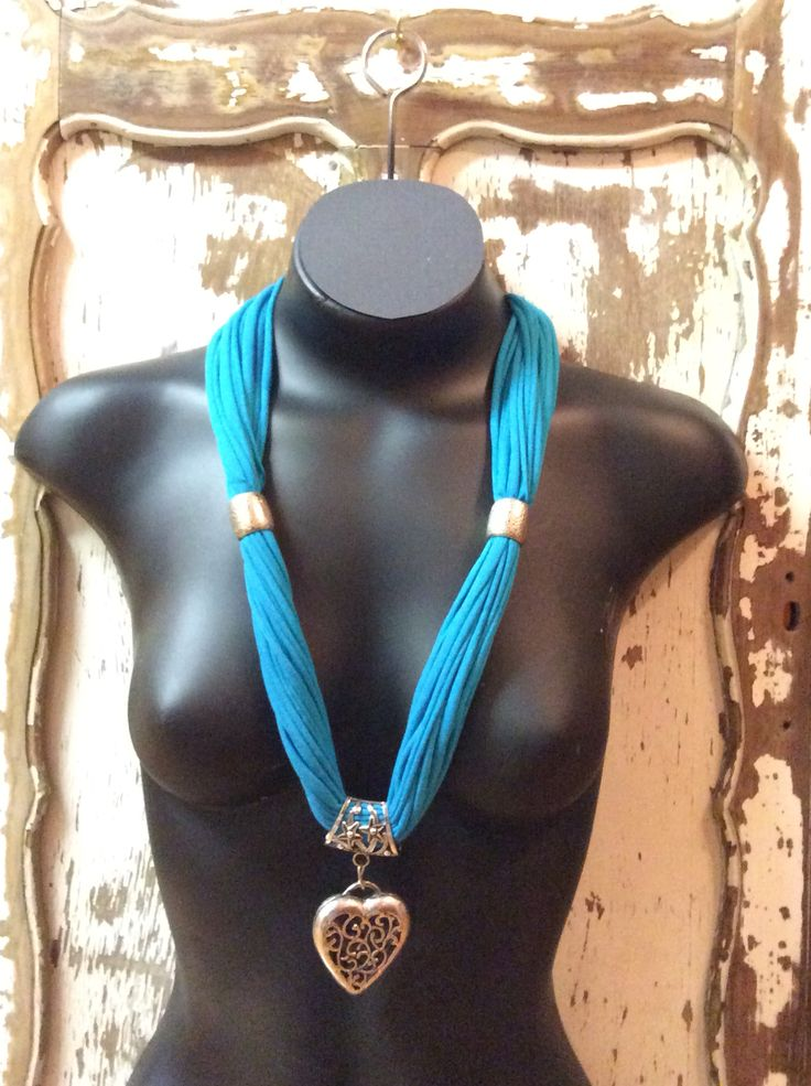 Aqua necklace with heart pendant