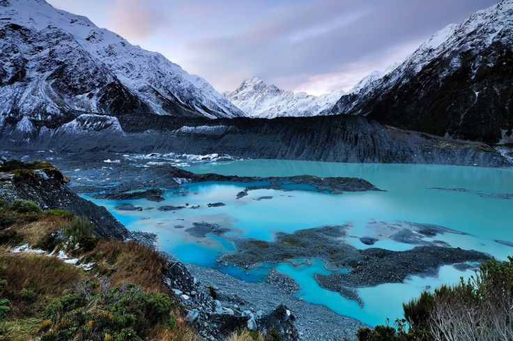 Sunset and dusk over Mt. Cook in the South Island.. It is the highest mountain in New Zealand and a climber's paradise - a famous scenic destination ~ .