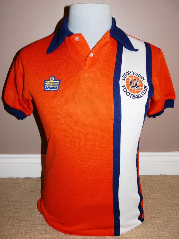 Classic retro Luton Town shirt from the late 1970's era when the club switched to orange home shirts for a spell.  This shirt is from either 1976-1978 season or the following 1978/79 one, the shirts and shorts are virtually identical between the two.