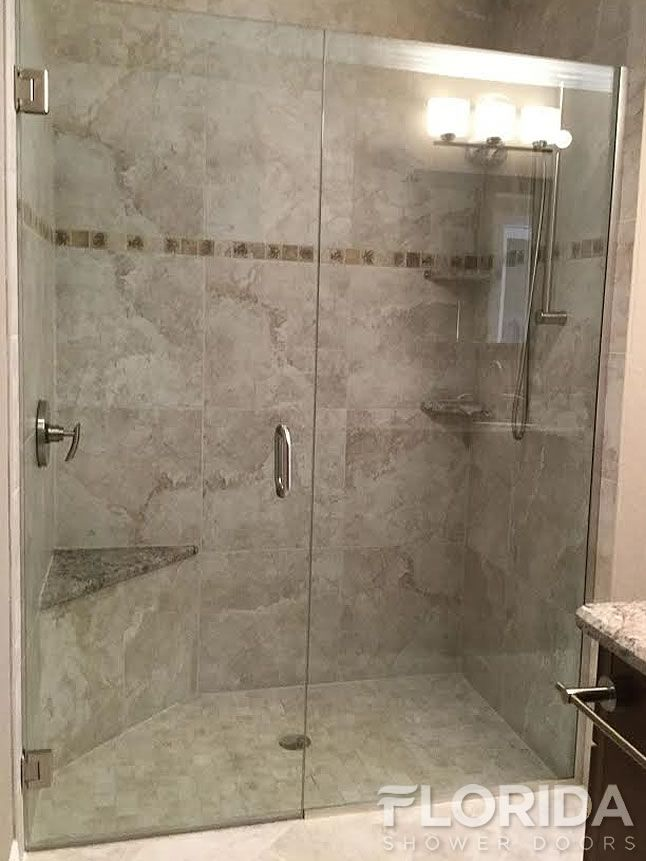 frameless inline glass shower door secured with uchannel u0026 brushed nickel hardware