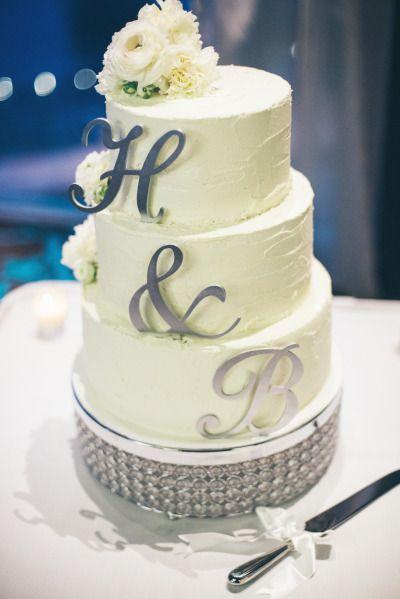 Silver monogramed wedding cake: http://www.stylemepretty.com/australia-weddings/new-south-wales-au/2014/12/23/elegant-spring-wedding-in-new-south-wales/ | Photography: Dominique Cherry - https://www.facebook.com/deccreatives