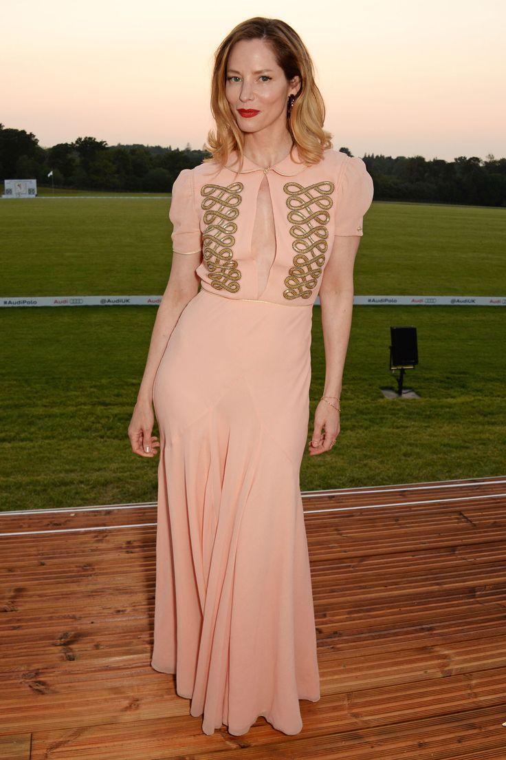 28 May Sienna Guillory opted for a pretty peach dress with gold accents.   - HarpersBAZAAR.co.uk