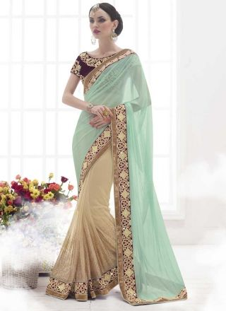 Sea Green and Chiku embroidery work net designer saree  http://www.angelnx.com/Sarees