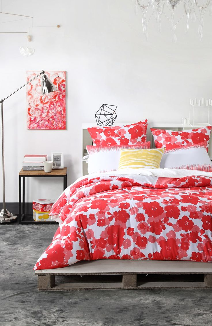This bright, reversible floral-print comforter adds such a refreshing pop of color, and totally livens up the home décor.