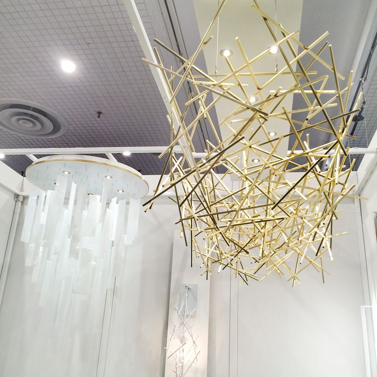 The Satin Brass CRISS-CROSS Chandelier and Movimento Round featured at #icffnewyork #2016 #ridgelystudioworks #customlighting #design