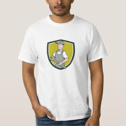 Repairman Holding Spanner Crest Cartoon Shirt. Illustration of a repairman handyman worker wearing hat and overalls holding spanner wrench looking to the side viewed from front set inside shield crest done in cartoon style. #Illustration #RepairmanHoldingSpanner