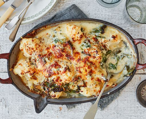 Steal the show with this creamy cauliflower cheese, featuring crispy kale and a gooey blend of cheddar, manchego and hard cheese.   Tesco