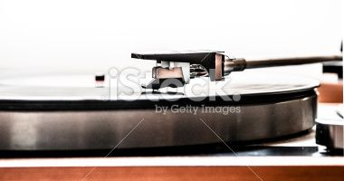 Side view of a turntable head on an LP Royalty Free Stock Photo