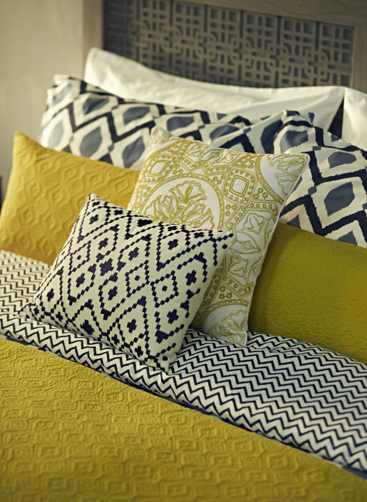 transitional custom bedding. citrine. white, and charcoal geometric patterning.