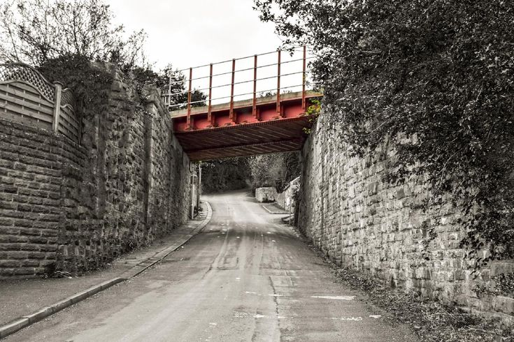 Taken near the entrance to Brockholes Railway Station, West Yorkshire the bridge carries the Penistone Line railway over the road. This was taken in May 2016. More pictures and links on my blog at, www.colingreenphotography.blogspot.co.uk