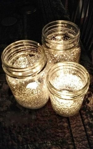 Mix water with Elmer's glue and brush the inside of the mason jars. Add glitter of your choice to the inside of the jars, and roll/spin the jar around until the glitter coats the sides. Let dry and add a tea light! by kimberly