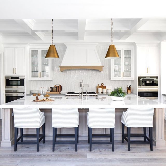 Coffered ceilings and a show stopping vent hood; huge island